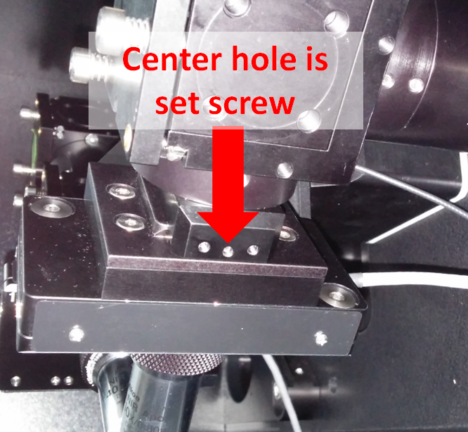 Set screw for loosening the piezo assembly from the SPIM arm